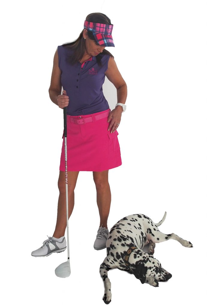 Monaco Golf Skort shown with option of Pohli Belt in Rose.   Model also wears Pohli sleeveless top in Purple/Rose and Visor in Tasker Check.